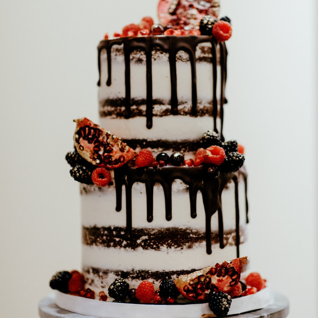 Semi naked 2 tier drip cake with fresh fruit