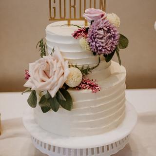 Textured buttercream 2 tier wedding cake with fresh flowers