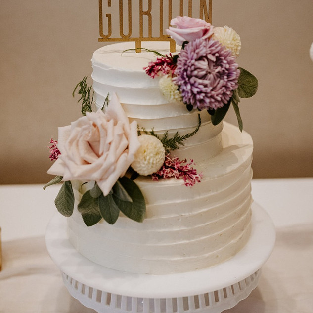 Textured buttercream 2 tier wedding cake with fresh flowers