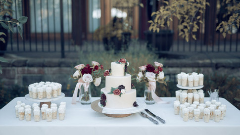 Wedding cake and dessert bar with tres leches dessert cups