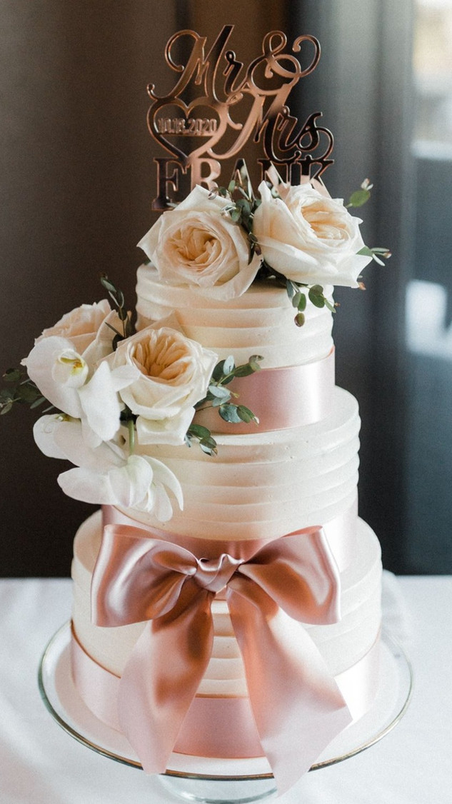 Textured buttercream wedding cake, rose gold ribbon, fresh flowers