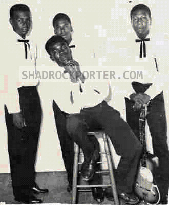 Photograph -- Desmond Wray, Herman Marshall, Aubrey Cummings, with Nicky Porter sitting on stool.