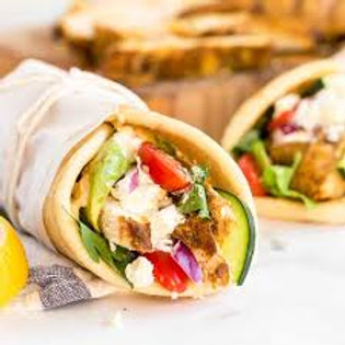 Shawarmas - Mediterranean flavored meat and fresh greens in a pita wrap