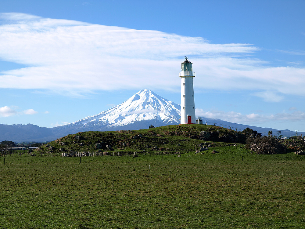 Cape egmont lighthouse and mt taranaki new zealand