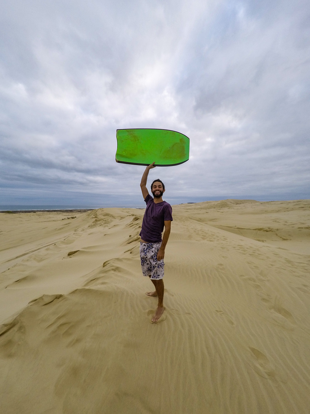 Sandboarding on te paki dunes new zealand