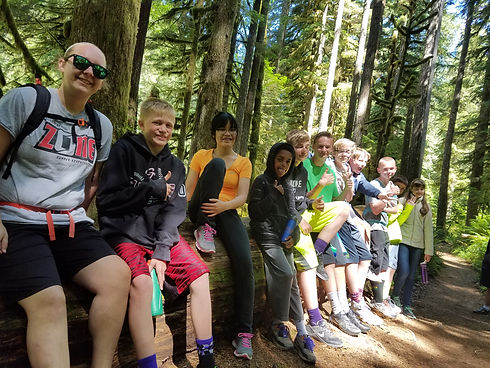 Kids on a hike in Oregon during summer camp