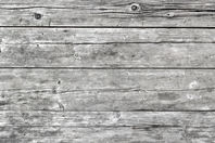 Rustic aged grey wooden table top view.