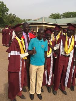 Teacher Dada Lawrence with grads