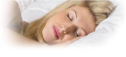 Woman Sleeping comfortably on her  SmartSilk™ Pillow