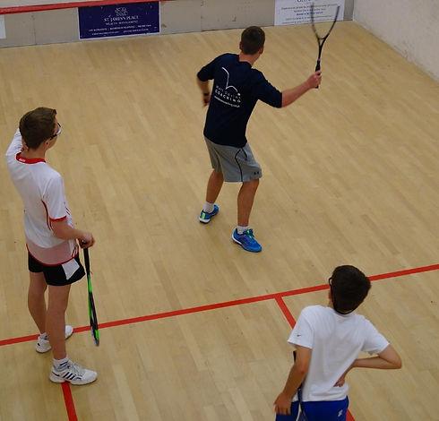 Squash coach demonstrating shot