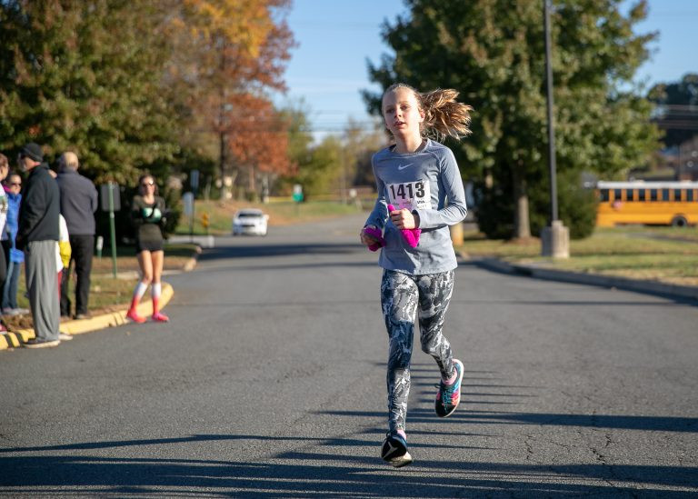 Young girl participating in 5k race.
