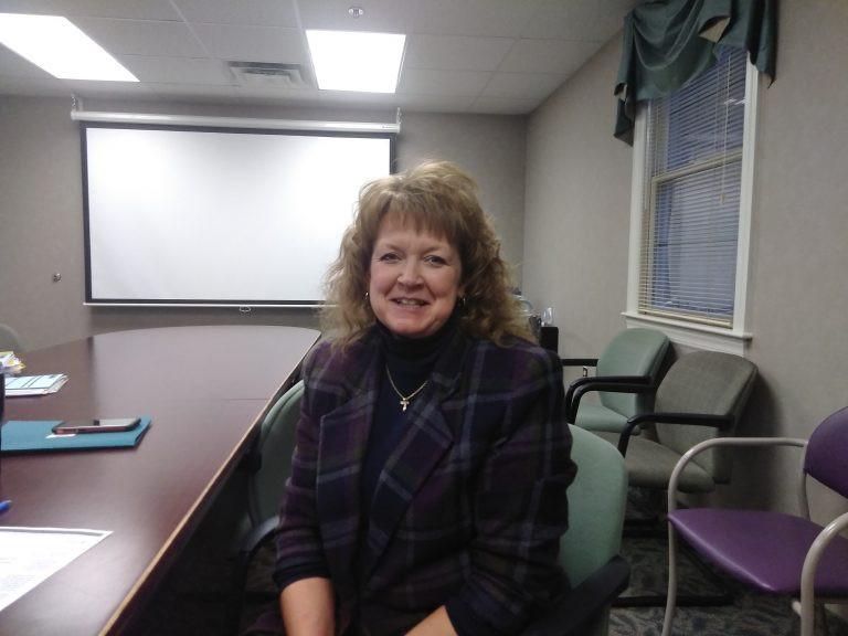 Lisa Springer, Nurse Practitioner, sitting in a conference room
