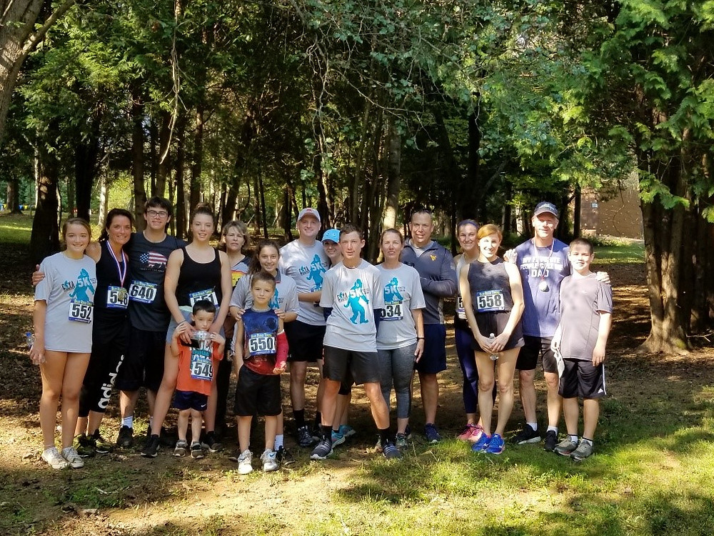 Strategic ACI employees and their families posing for a group shot before the Run for Your Life 5k