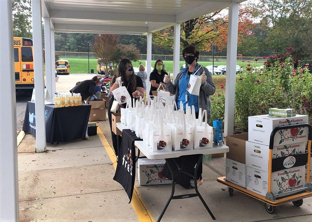Volunteers handing out grab-and-go meal bags