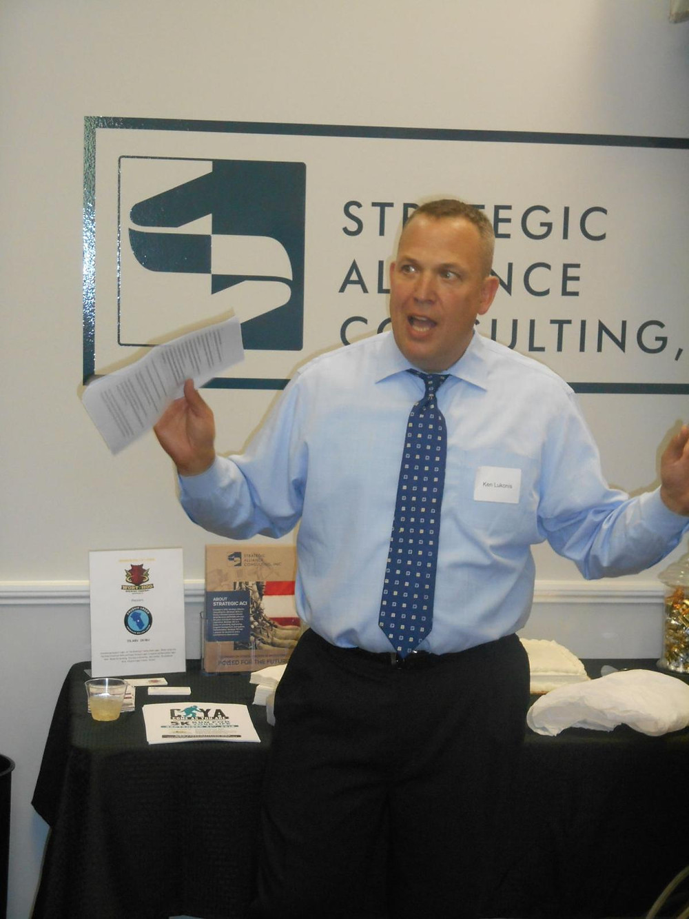 Strategic ACI's CEO addressing crowd at recent opening of new office.