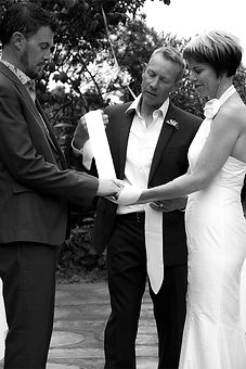 wedding photo of celebrant john allen binding the knot