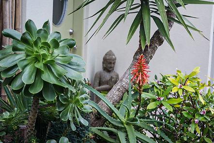zen garden with buddah and wild flowers