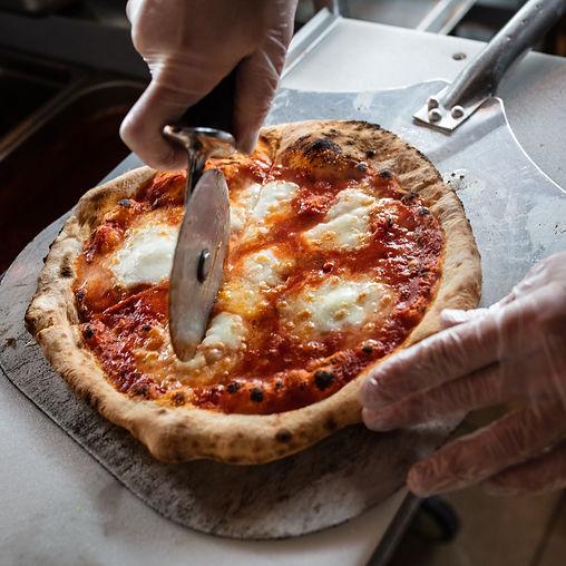 Cutting Pizza_credit Drew Katz.jpg