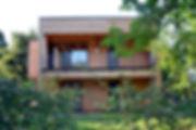 Casa in legno moderna, rivestimento in listelli in larice