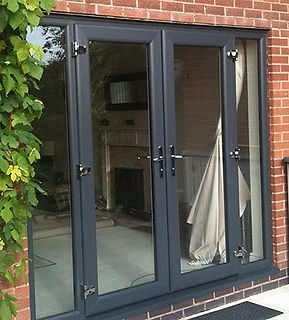 Patio Sliding French Bi-Folding Doors Aluminium Modern Contemporay Folding door tri-folding burgess hill haywards heath sussex FENSA Grey
