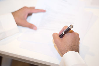 Saudi Business, Hands Signing a document