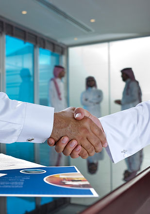 Saudi Arab businessmen shaking hands, an