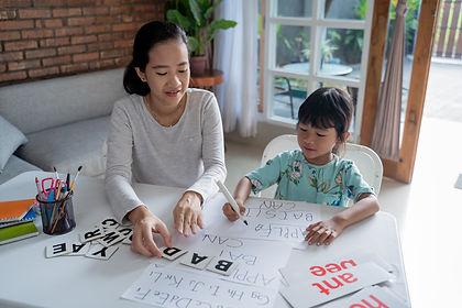 parent teaching phonics.jpeg