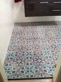 Concrete bathroom floor tiles.