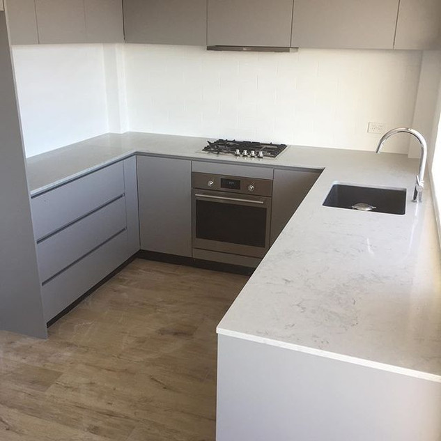 Gray with stone benchtop.