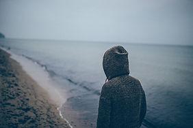 Man in sweatshirt on beach