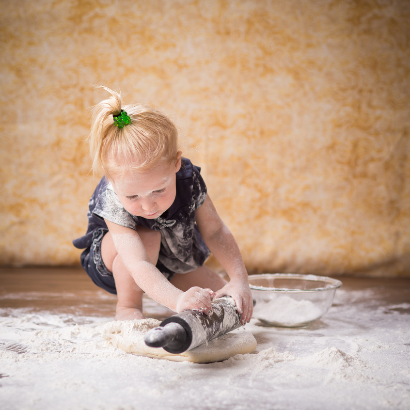 Kitchen photography with little girl rolling out dough in Overland Park