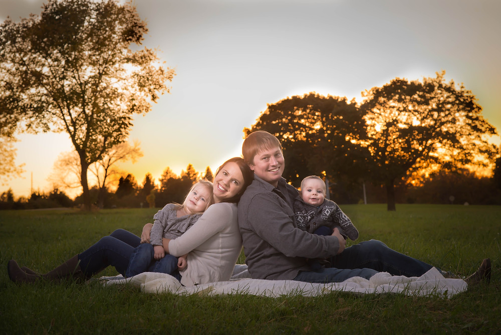 Kids snuggle in at the end of long photo session in Overland Park