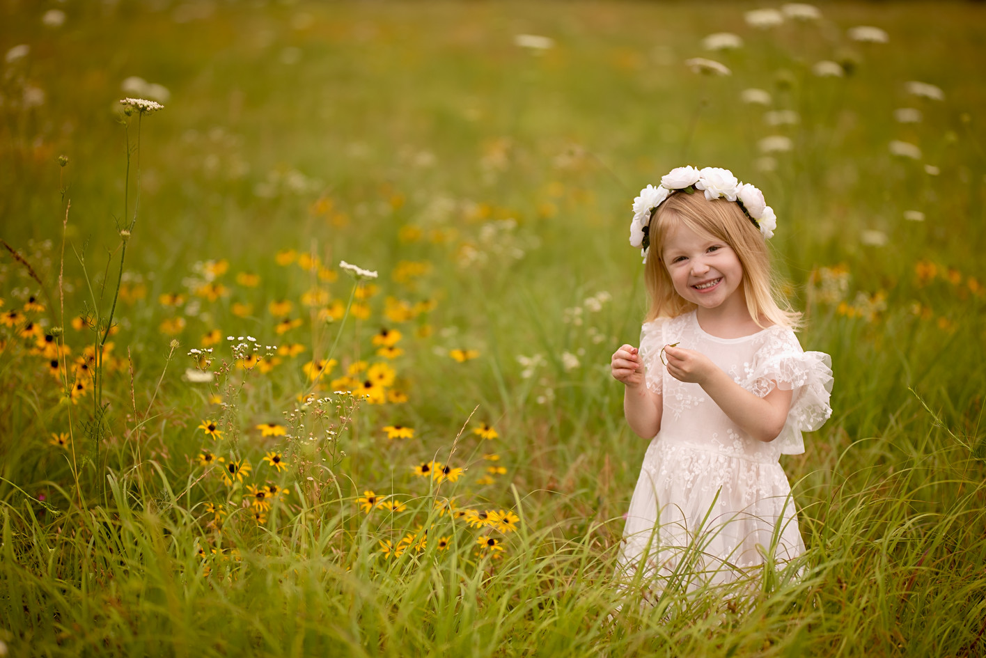 Candid smiling child with a flower crown