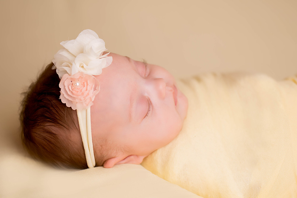 Glowing baby girl sleeping peacefully in Overland Park