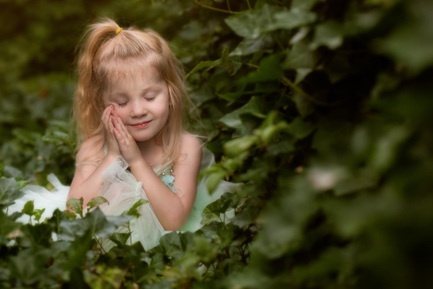 Little Girl Sitting in Ivy