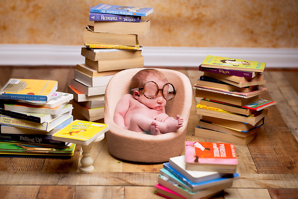 Library and Book themed newborn pictures by Overland Park photography