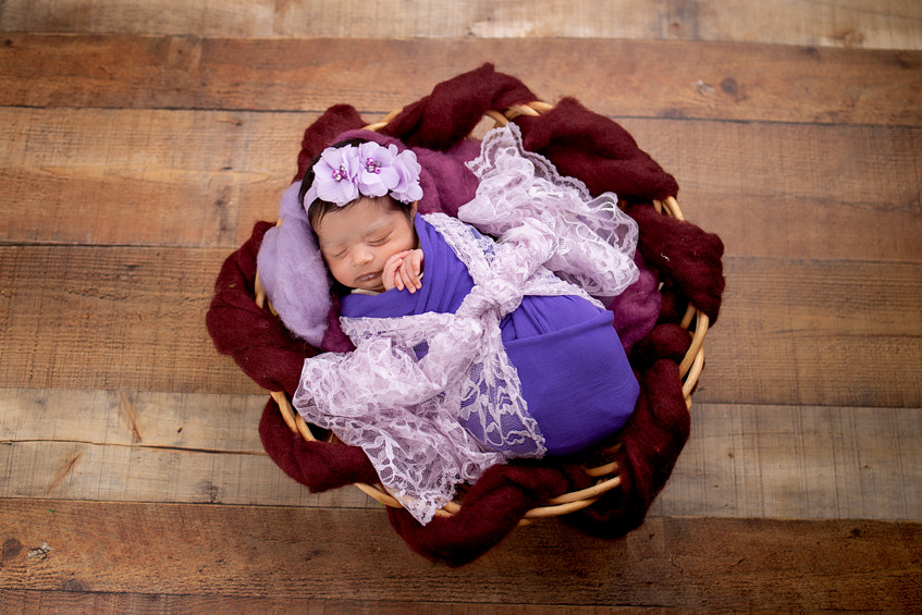 Best newborn picture for puple and lace lovers in Overland Park