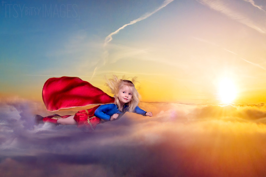 Super girl flying high over the clouds