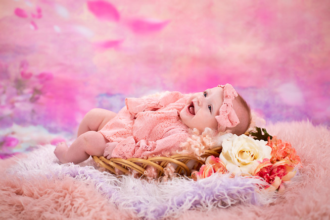 Laughing Baby Girl Picture with flowers and fur