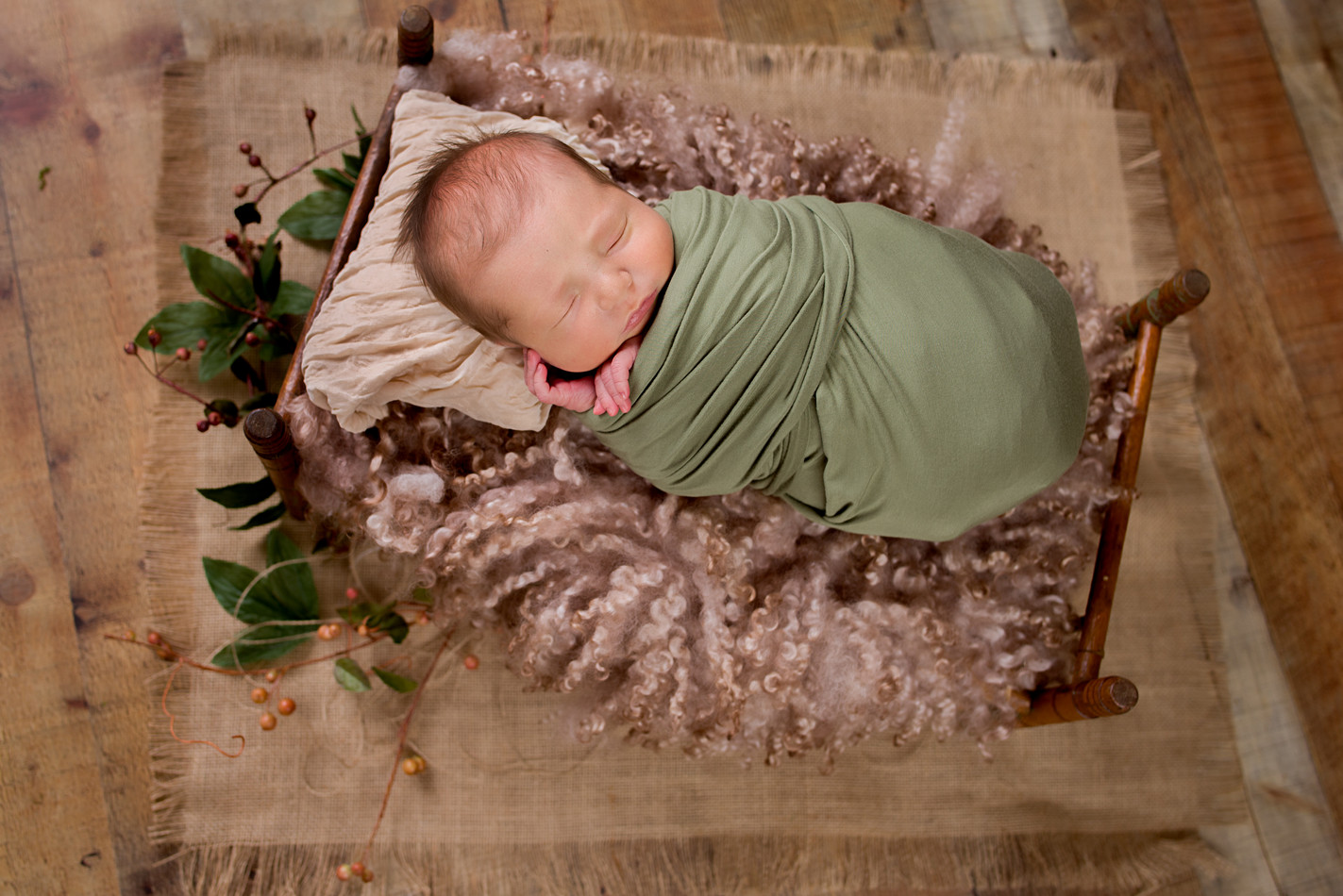 Rustic newborn photography with baby bed