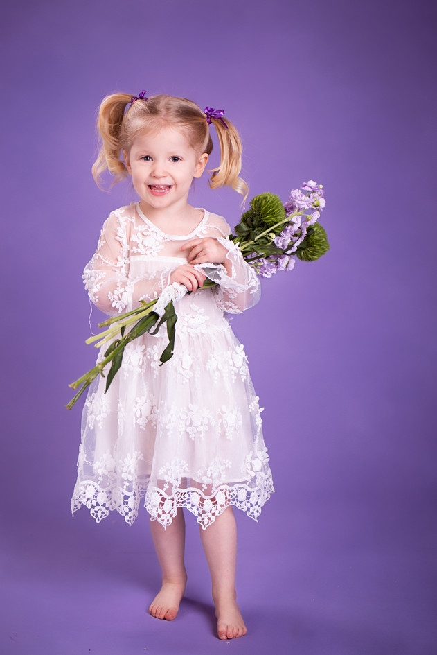 Childhood Delight with a Bouquet of Flowers