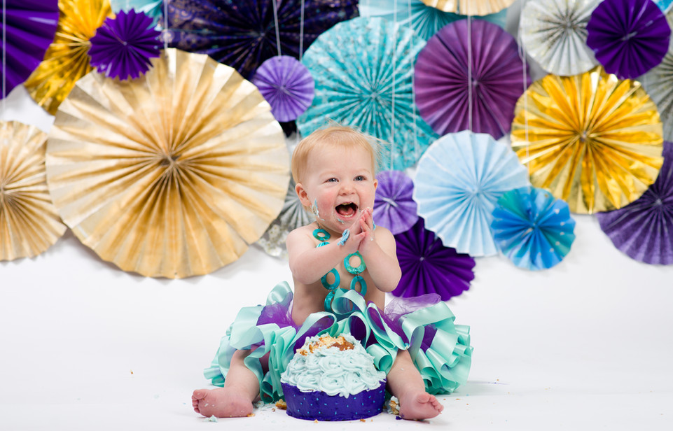Purple and teal cake smash