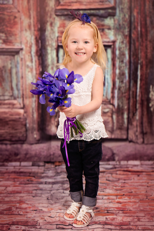 3 year old with a bunch of Iris flowers