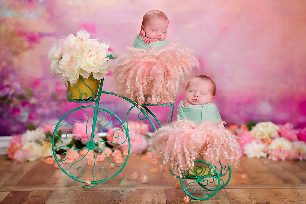 Twin baby girls riding a bicycle built for two by best Overland Park photographer