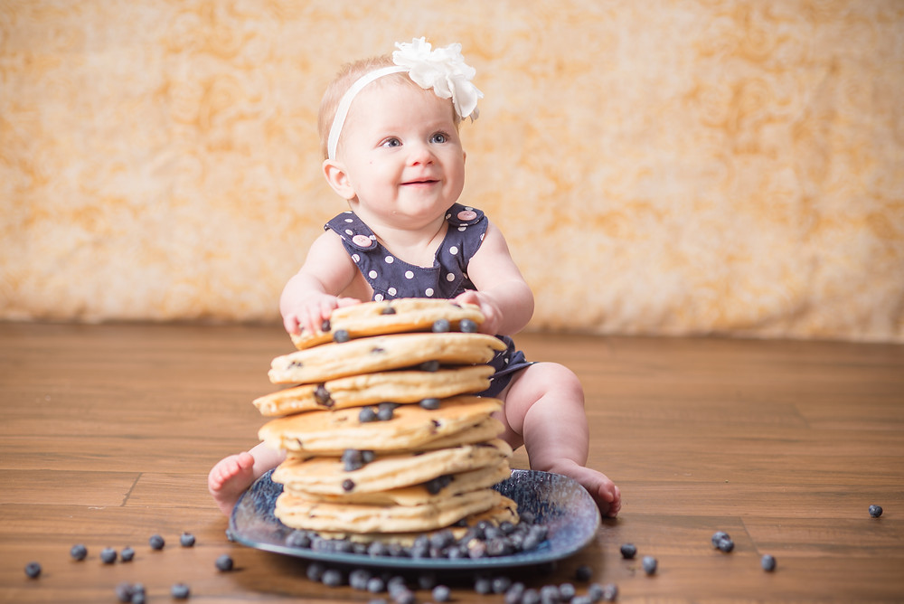 Baby with Giant Stack of Blueberry Pancakes