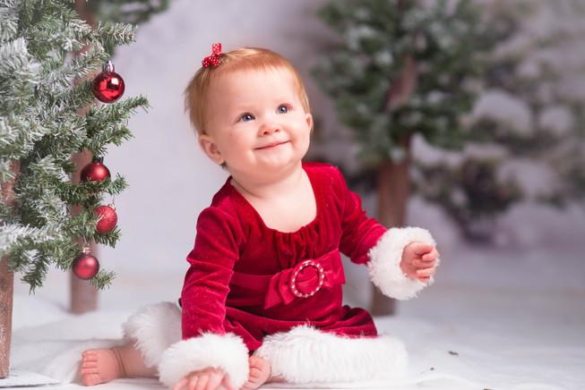 Winter baby in red velvet dress