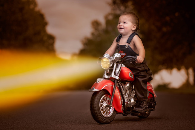One Year Old Driving a Motorcycle