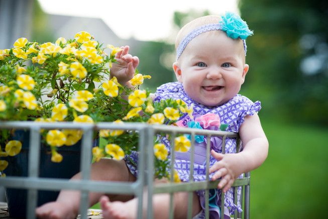 Baby picture in flower cart