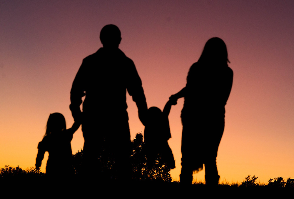Swinging the kids at sunset