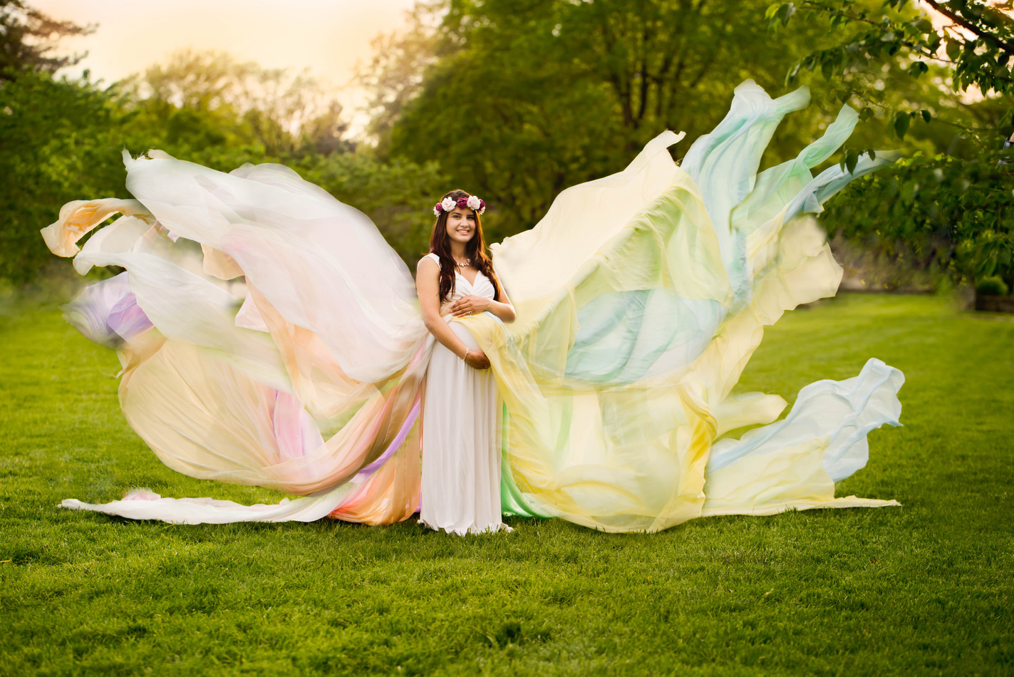 Rainbow maternity gown flying in the air